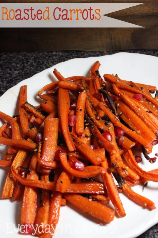 Roasted Carrots with a maple glaze, spiced up with coriander and topped off with pomegranate seeds. | EverydayMadeFresh.com