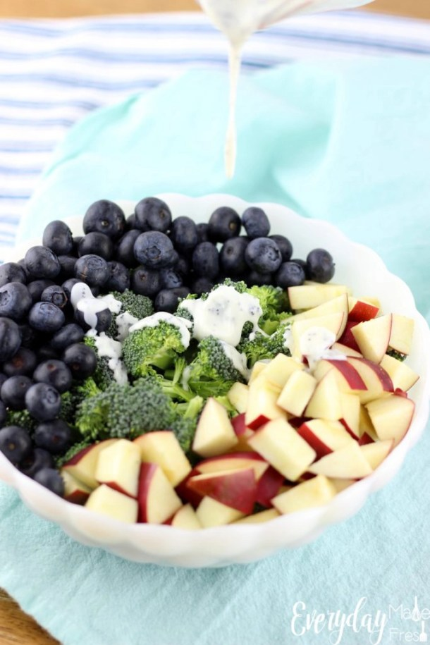 There is nothing skinny tasting about this Skinny Broccoli Salad with a Poppy Seed Dressing! It's loaded with chunks of apples, fresh blueberries, and dressed in a poppy seed dressing that's been sweetened with honey. | EverydayMadeFresh.com