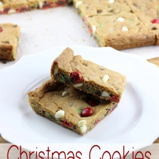 When you need to serve warm fresh baked cookies fast these Christmas Cookies for a Crowd are the answer. Baked in a sheet pan and filled with all the chocolate! | EverydayMadeFresh.com