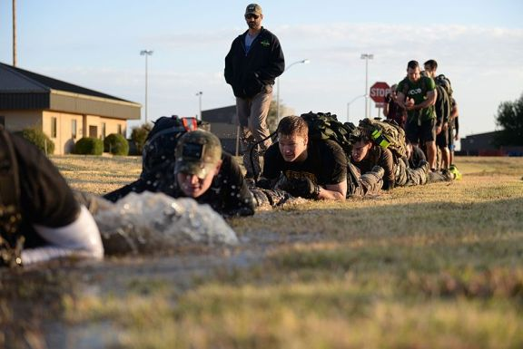 Participants in a GoRuck challenge, exhibiting tactical fitness