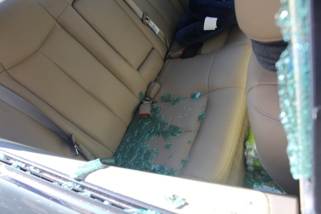 Broken glass everywhere. Lesson learned: Do not leave anything inside your car--- bags, keys, pouch, et cetera. They might arouse the curiousity of the thief.