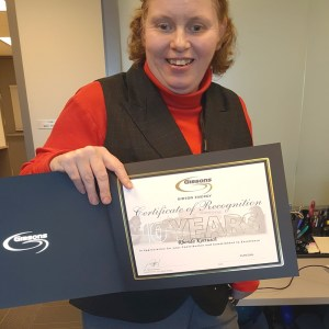 Central client Rhonda Kottusch shows off the certificate she received from Gibson Energy.