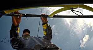 May 4, 2015. Leg 6 to Newport onboard Team Brunel. Day 15. Pablo Arrarte sending the boat and getting soaked.