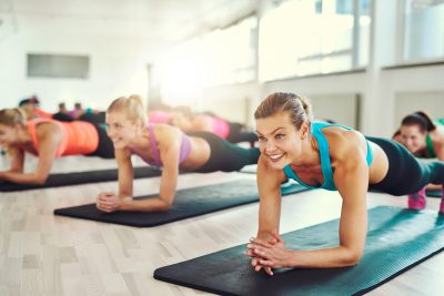 Young women working out together on rugs