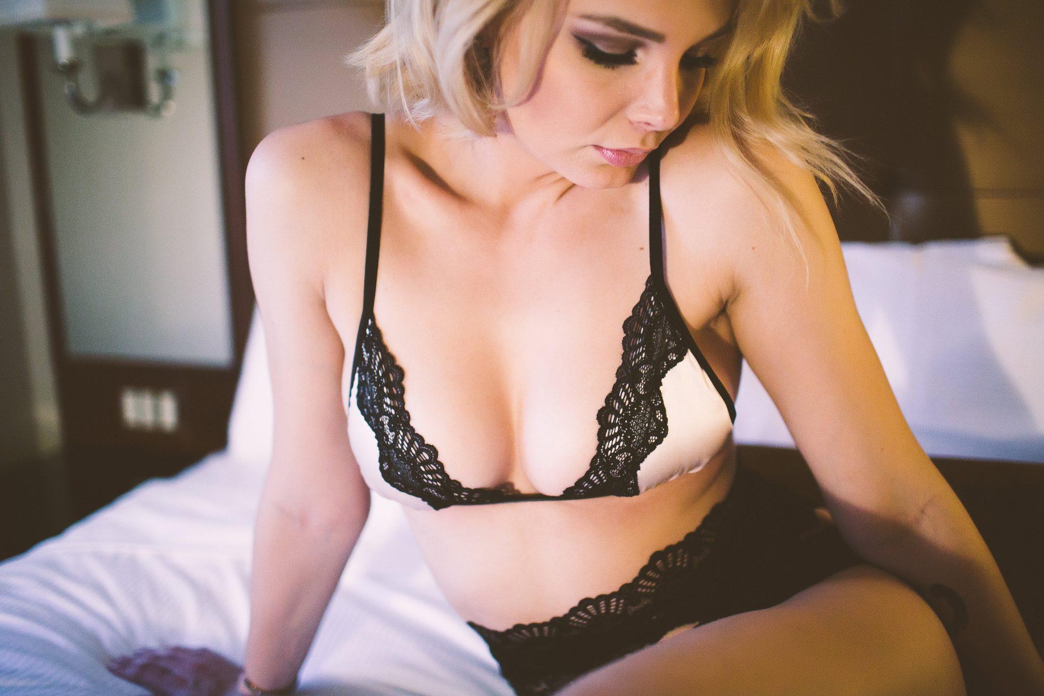 A woman taking boudoir photos at a bachelorette party