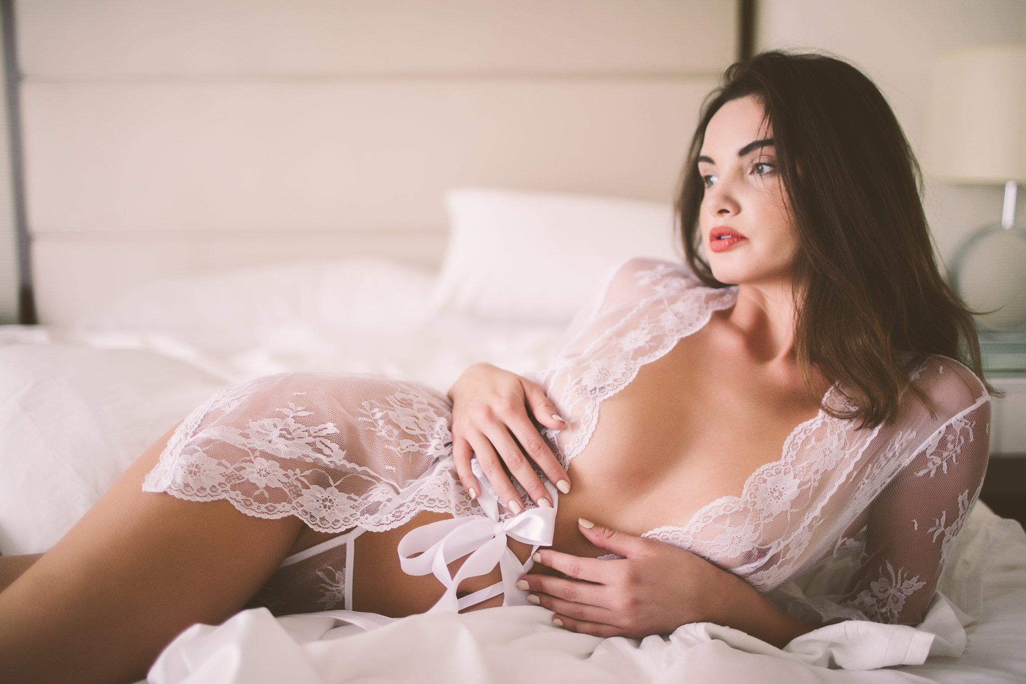Model taking a sensual photo wearing lingerie