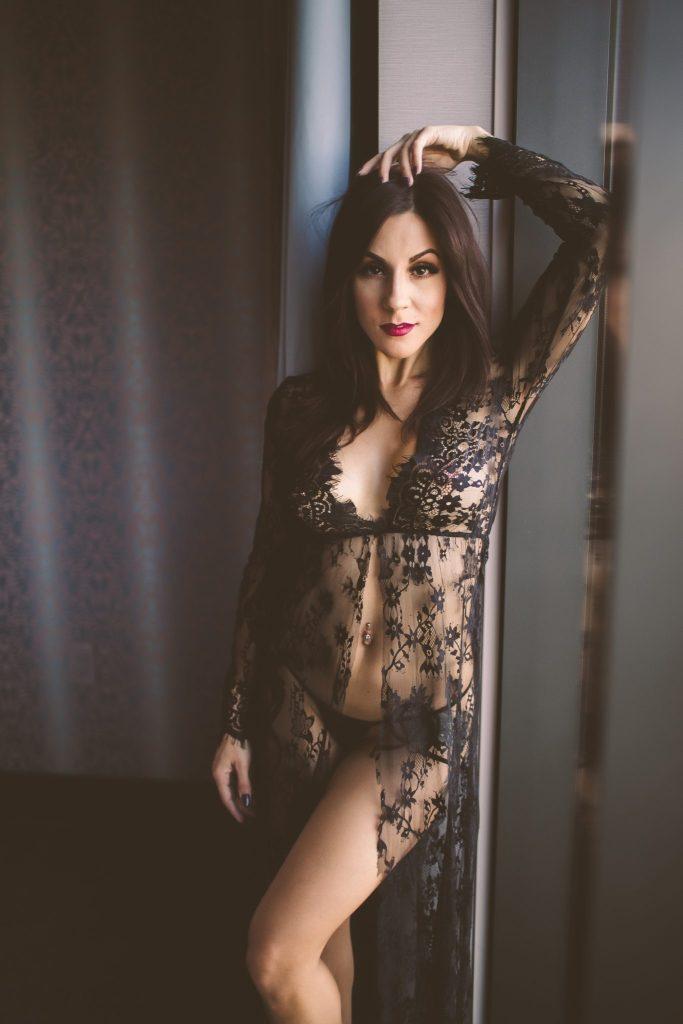 Woman wearing black lacy lingiere