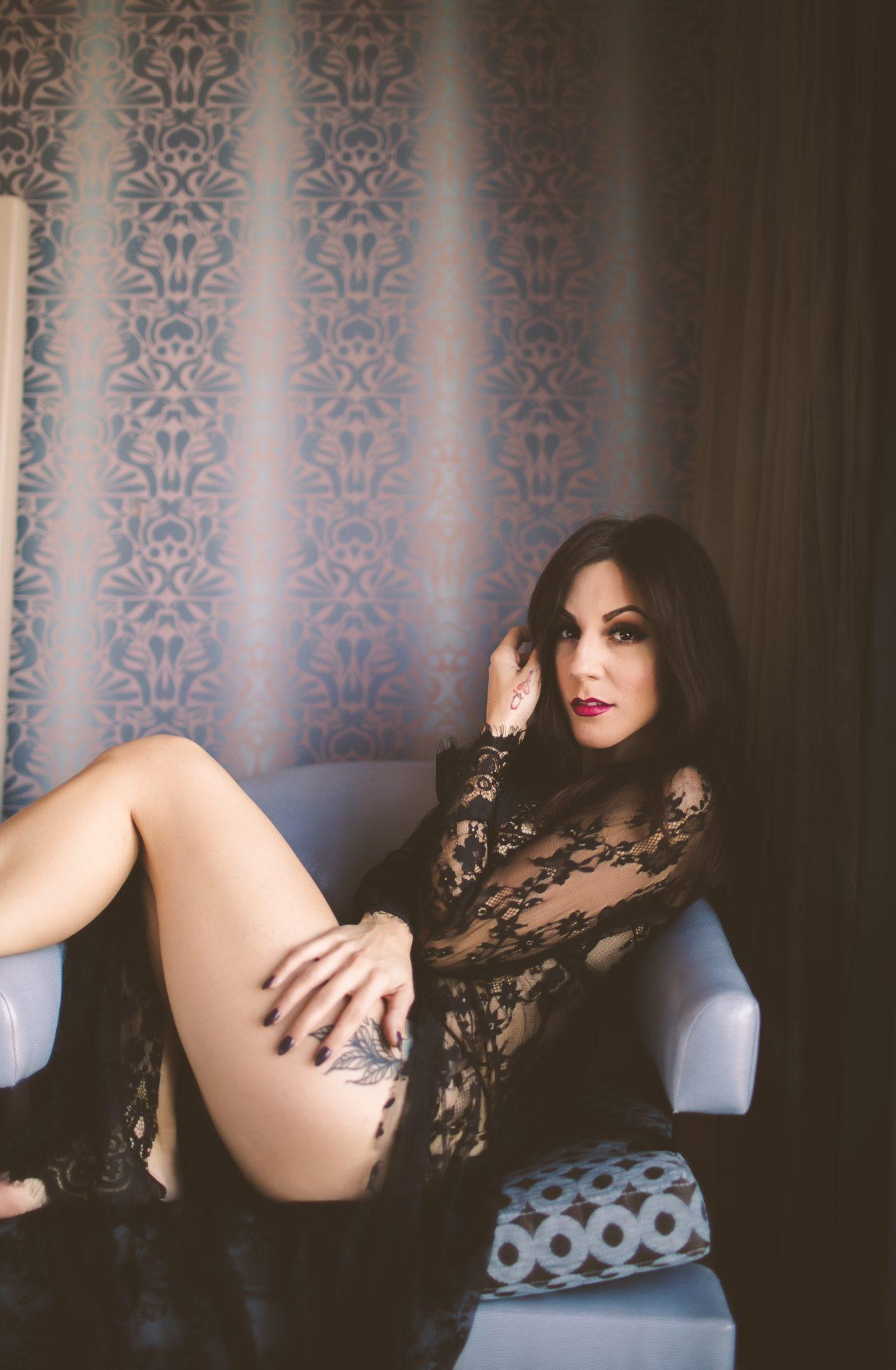 A woman taking boudoir photos