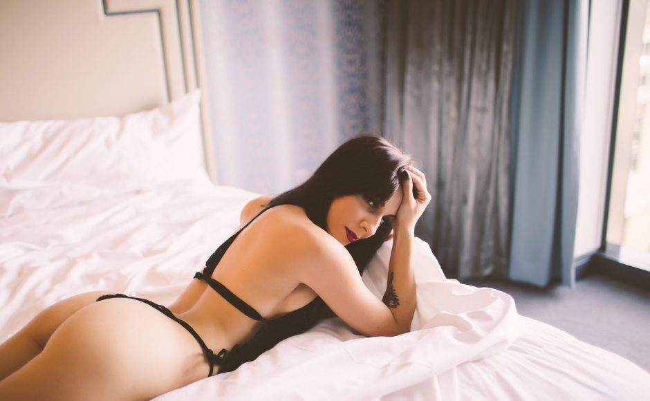 Boudoir photo of a woman laying on a bed