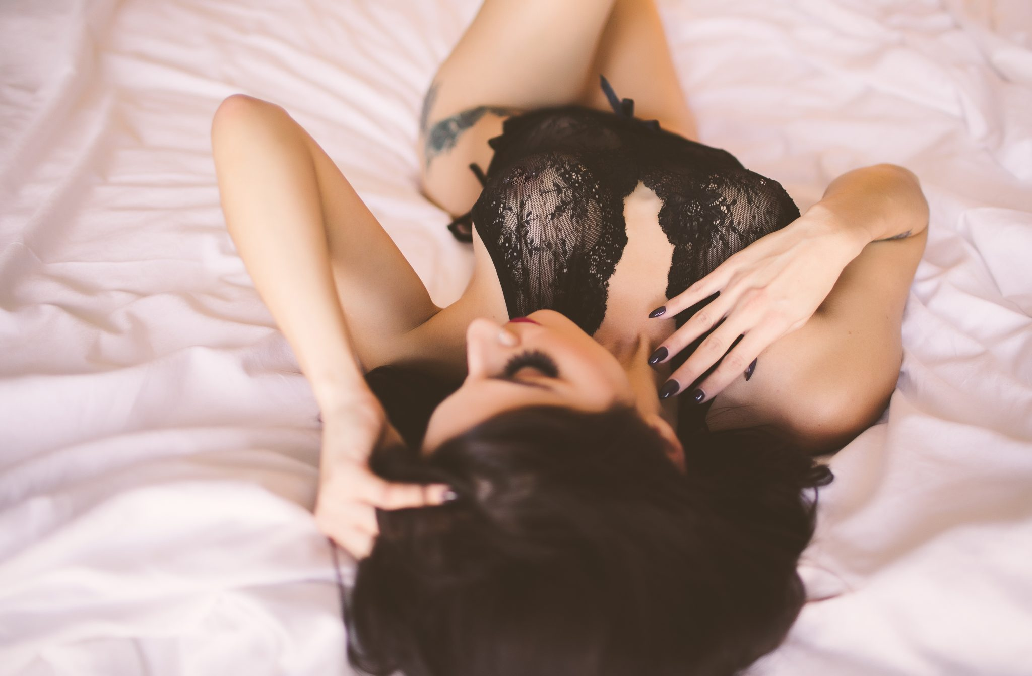 Model wearing black lace lingerie on a photo shoot