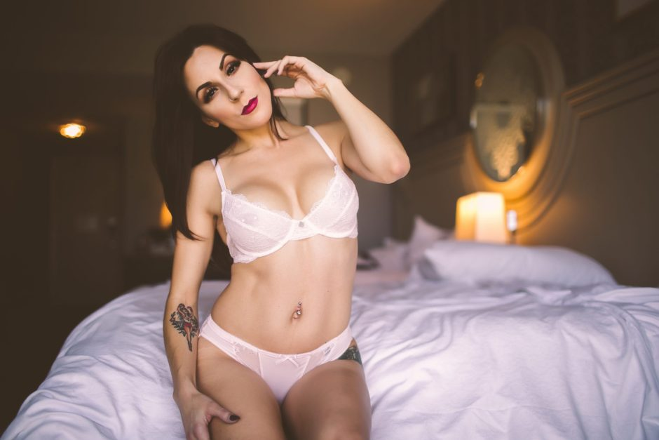 Beautiful lingerie model with tattoos and piercings