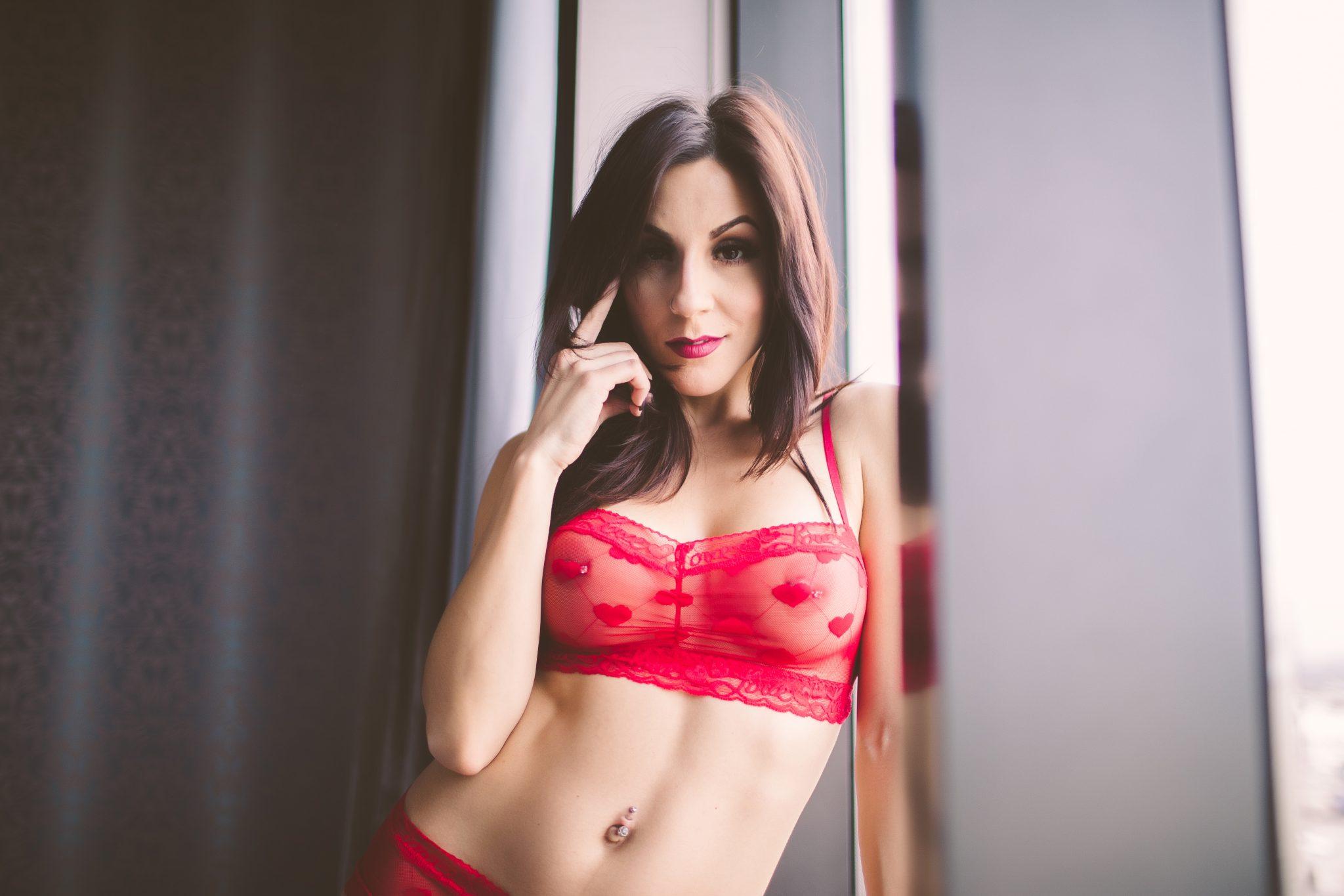 Model wearing pretty red lingerie