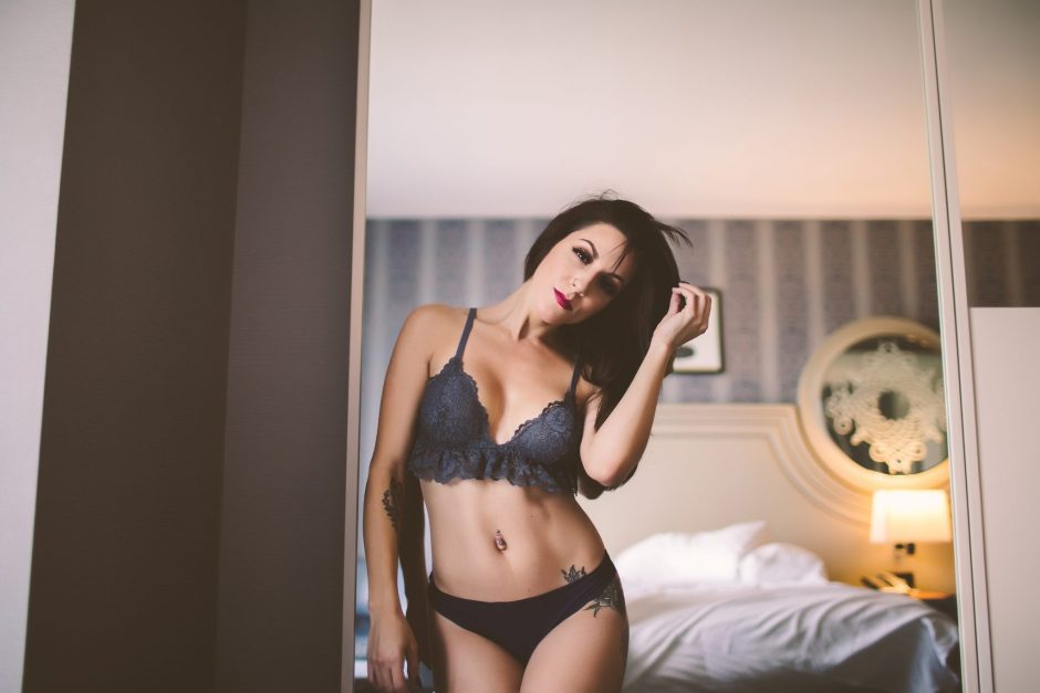 A lingerie model gazing at her reflection in a mirror