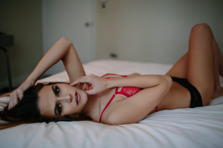 Model posing on a bed for a sexy photo shoot
