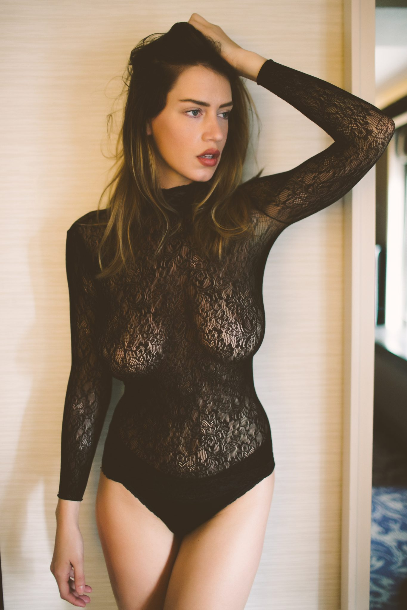 Model wearing see through lingerie
