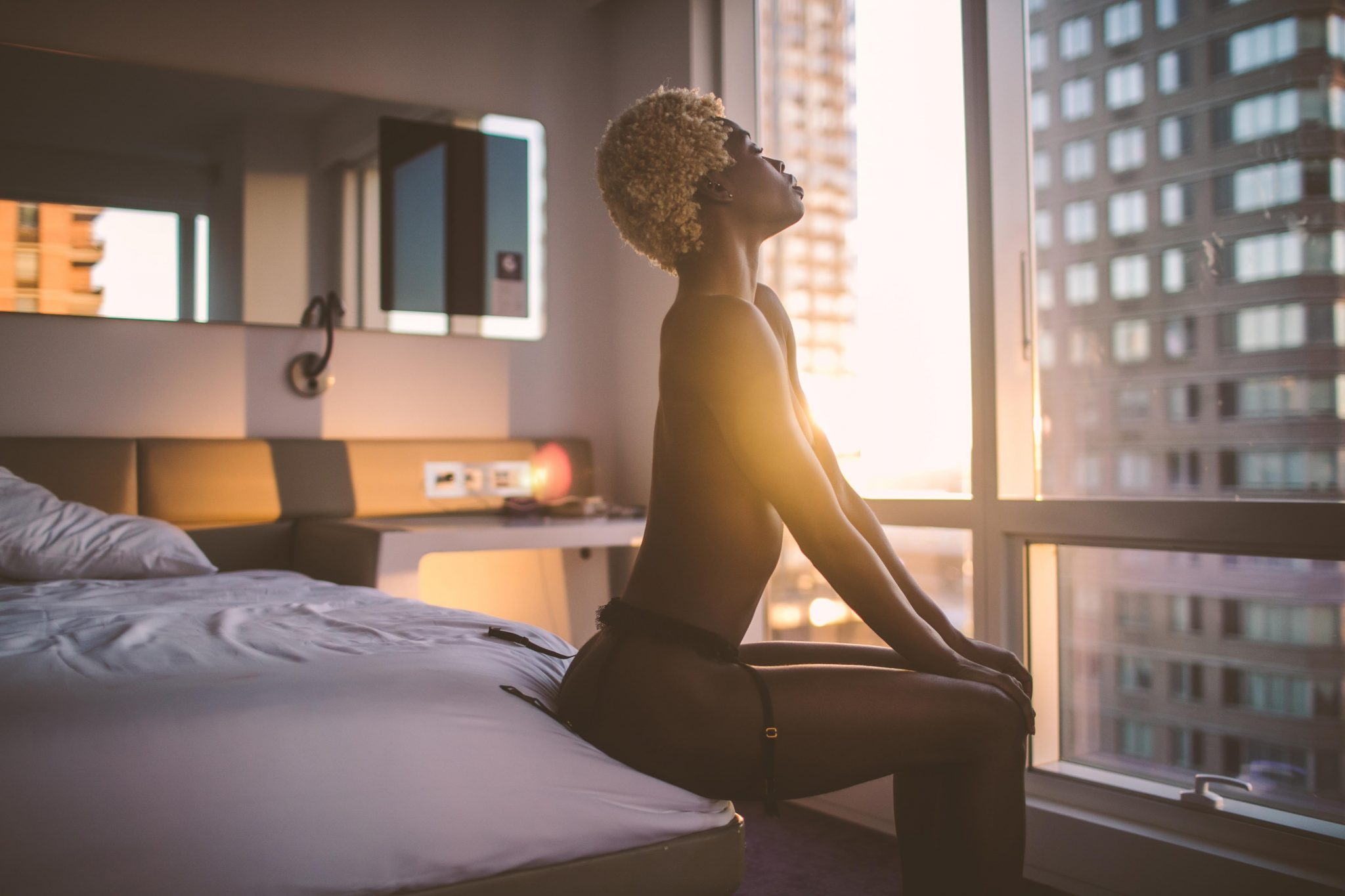 A woman posing on a bed for sexy photos