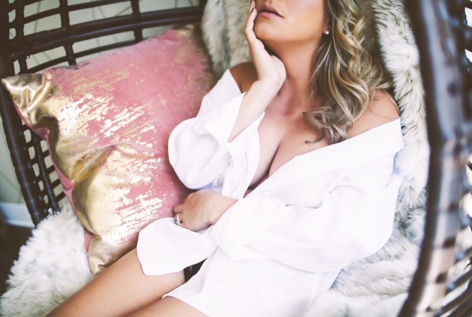 A sexy woman posing an a white shirt