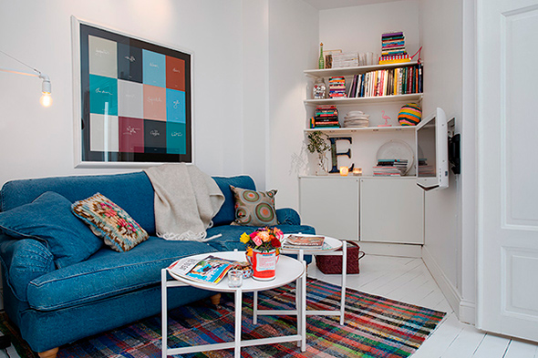 stylish-blue-jeans-sofa-small-coffee-table-white-apartment-living-room