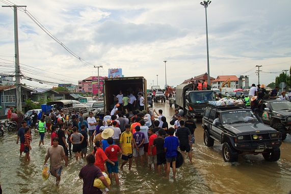 """""""AYUTTHAYA THAILAND - OCT 14 : flood victims around a container truck of volunteer to get some food and drinking water on October 14,2011 in Ayutthaya Thailand; Shutterstock ID 89334790"""""""