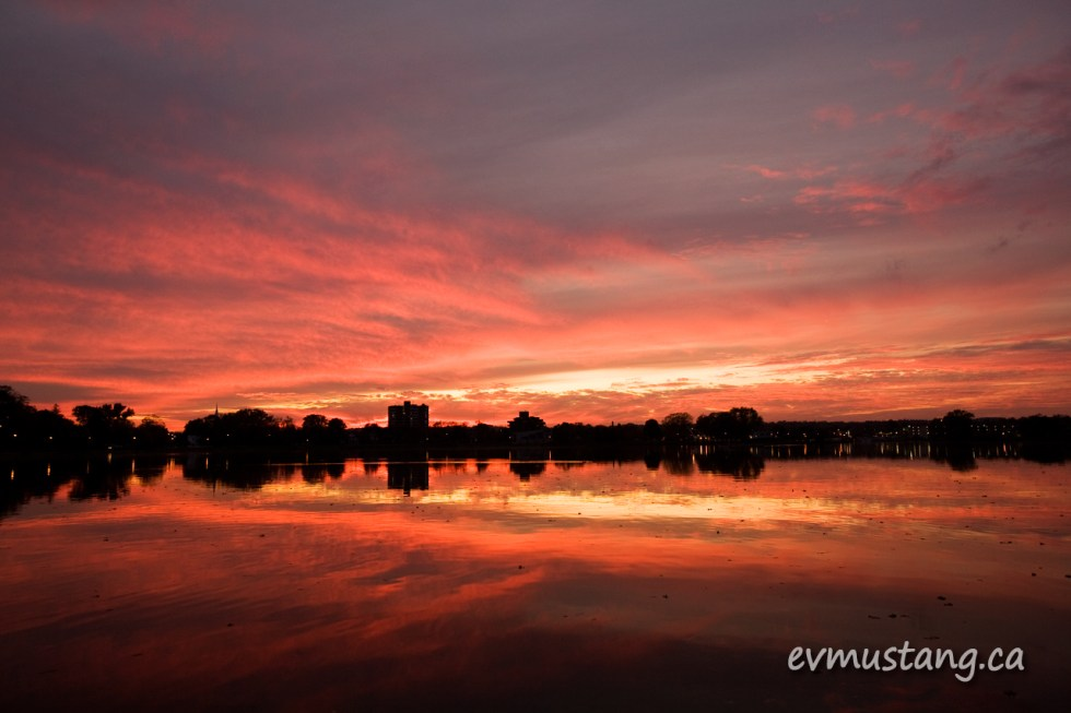 image of brilliant red sunset over Little Lake, Peterborough, Ontario