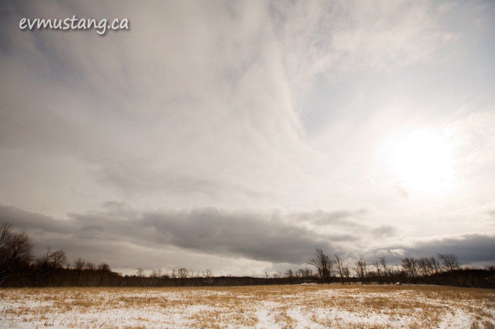 image of field with snow and clouds