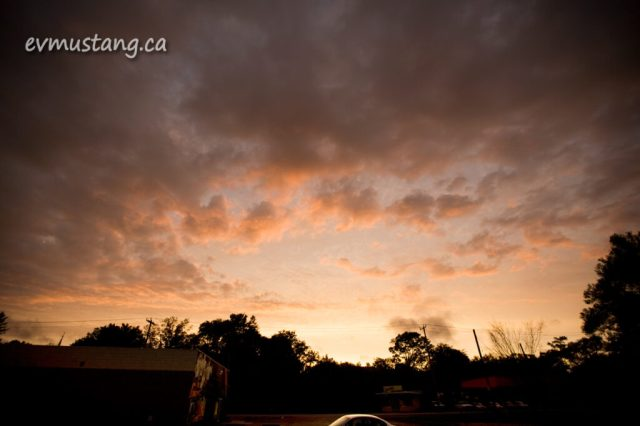 image of sunset over urban parking lot