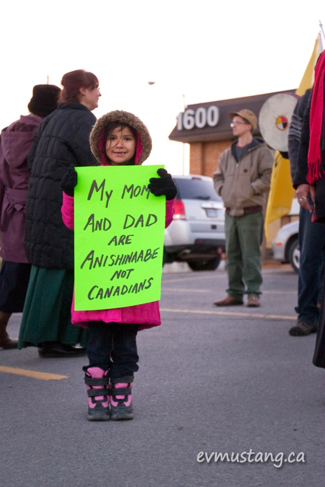 image of young anishinaabe woman at idle no more protest peterborough