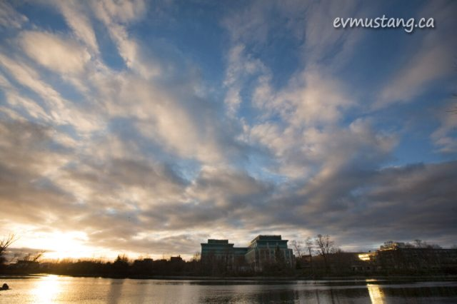 image of the otonabee river and the mnr building at sunset