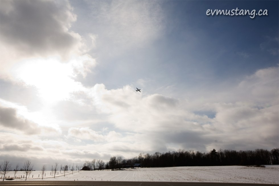 image of bomber flying through a winter landscape