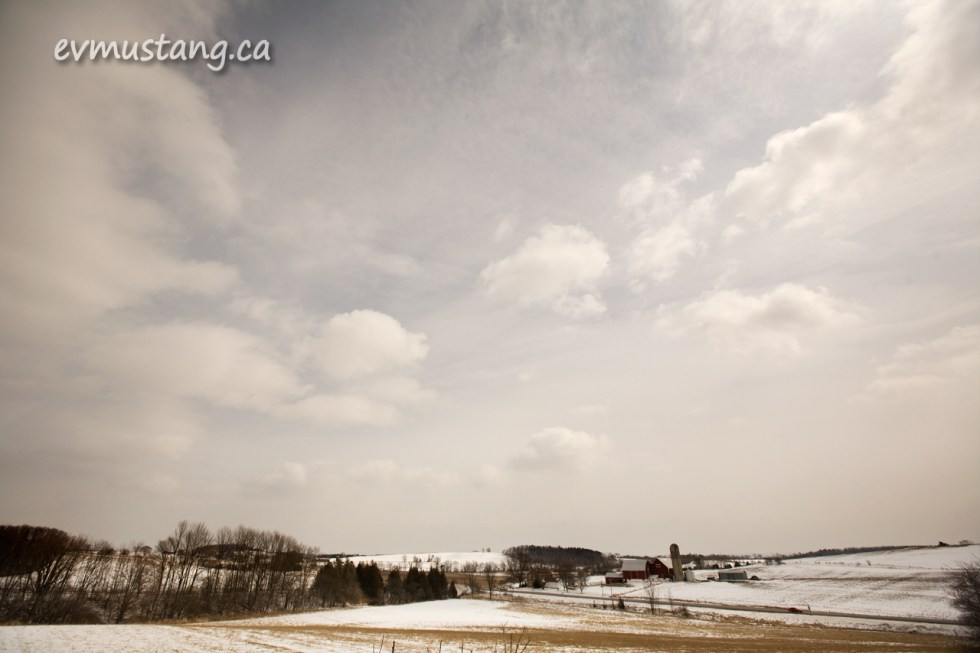 image of field and farm in late winter