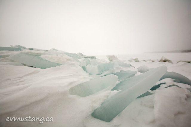 image of translucent blue ice breaks on lake shore