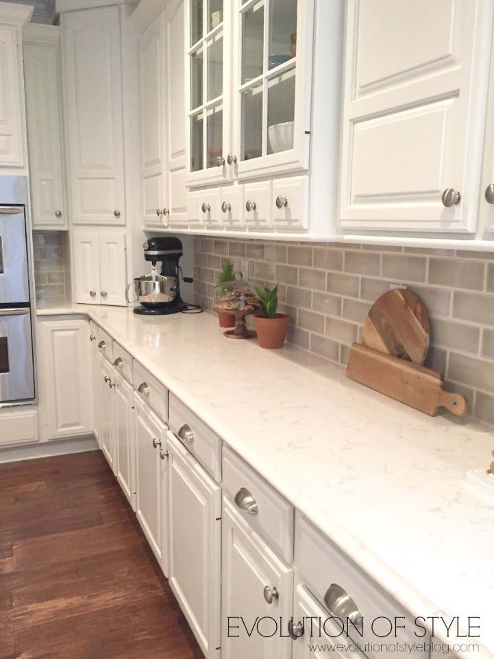White Cabinets with taupe backsplash