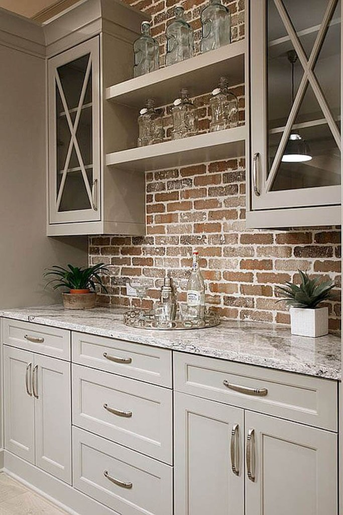 Brick backsplash gray cabinets