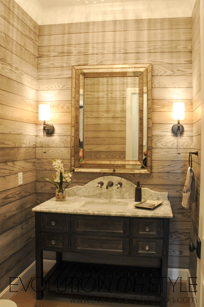 Stained wood shiplap powder room