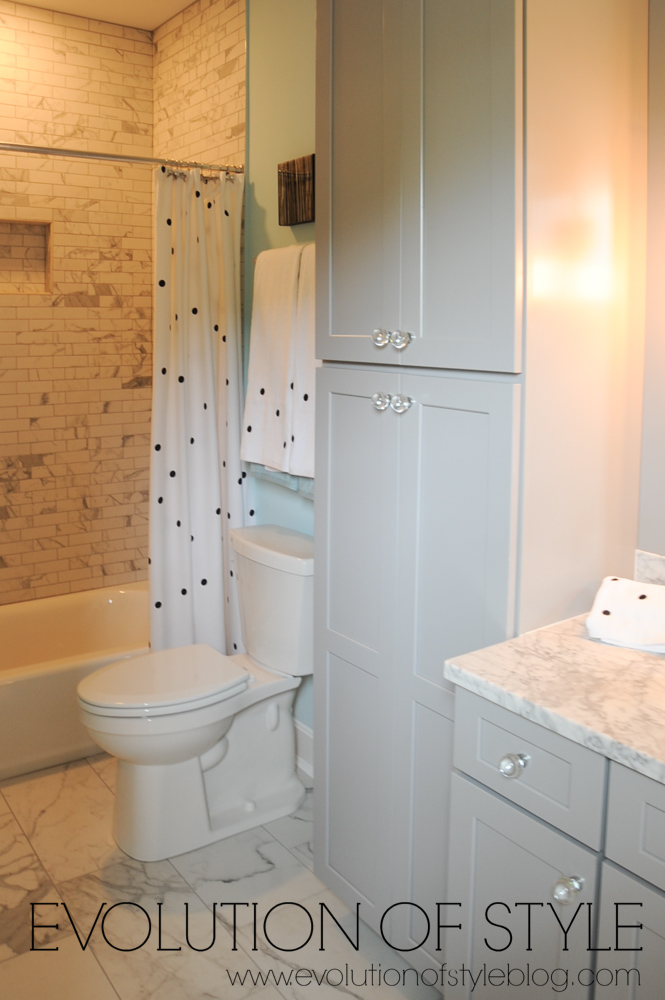 Girl's bathroom with taupe cabinets