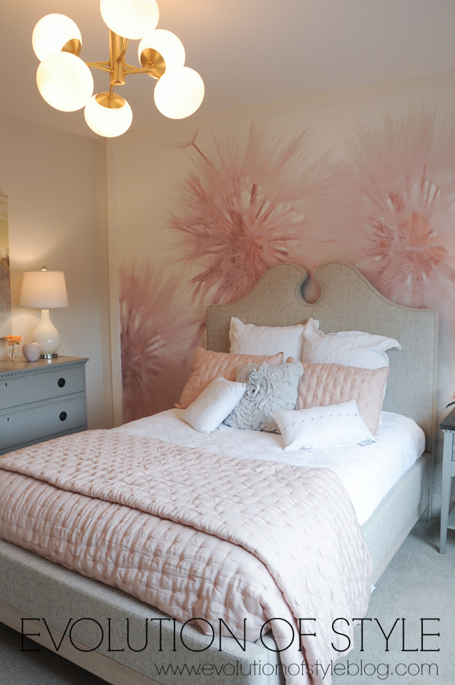 Pink bedroom with mural