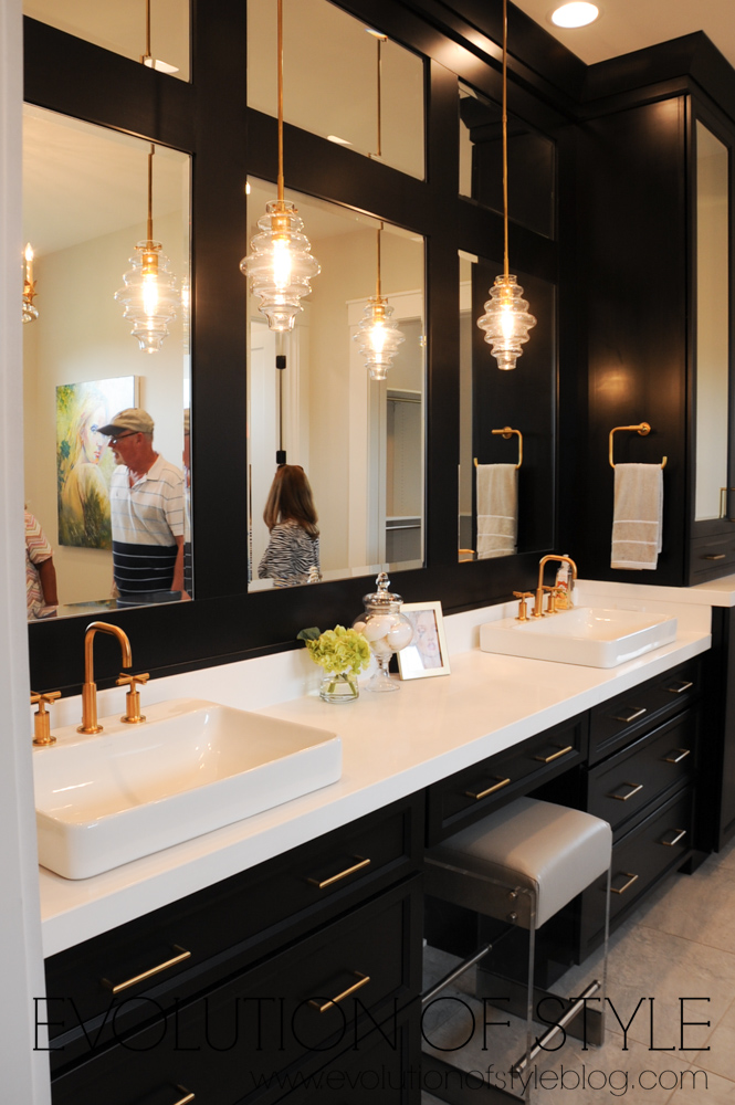 Master bathroom with black cabinets and gold hardware