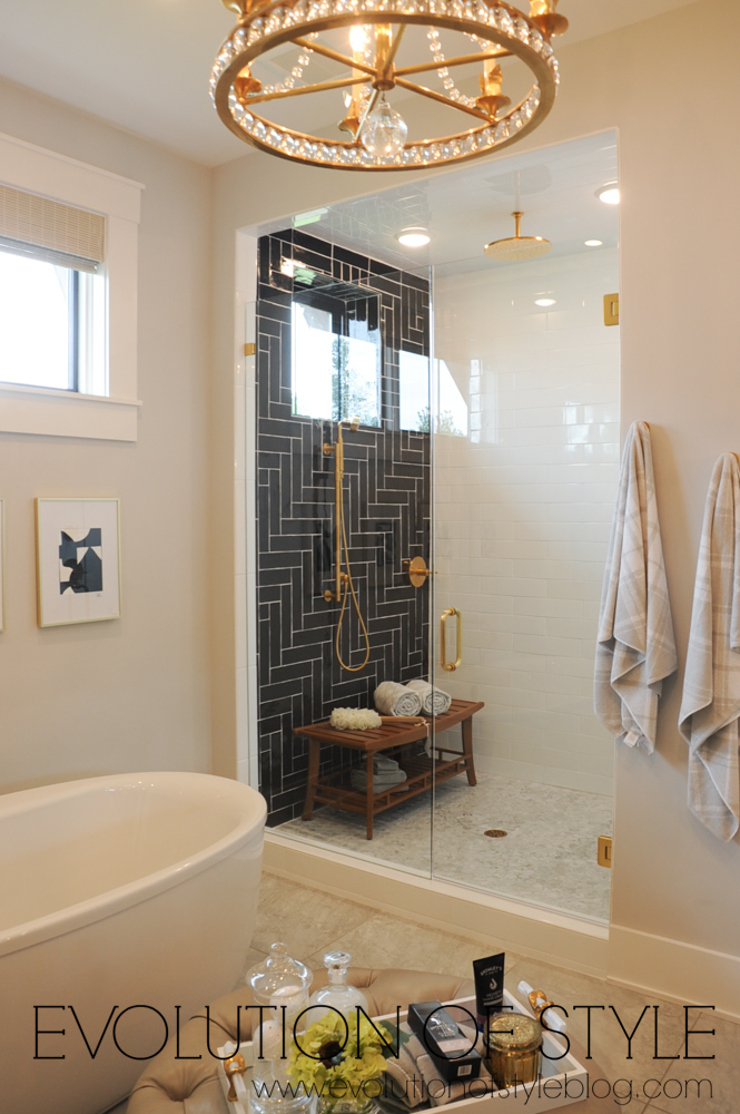 Master bathroom with black subway tile
