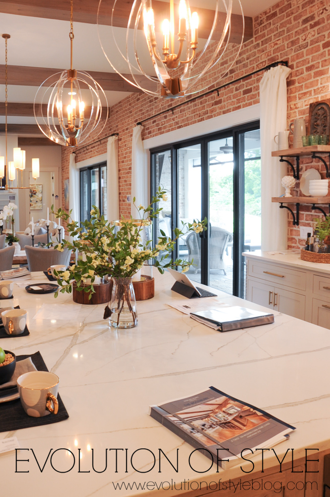 Exposed brick kitchen with large island