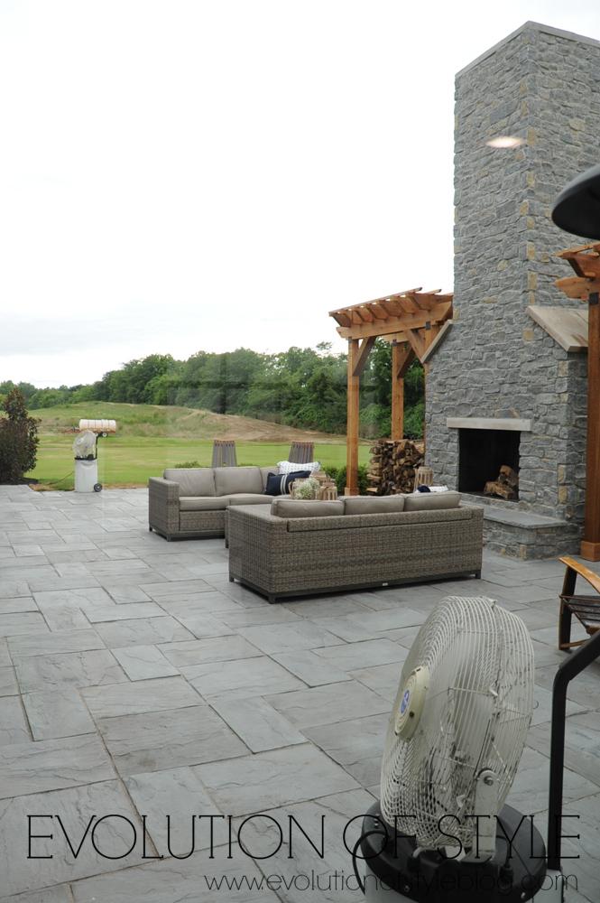 Modern farmhouse backyard with fireplace