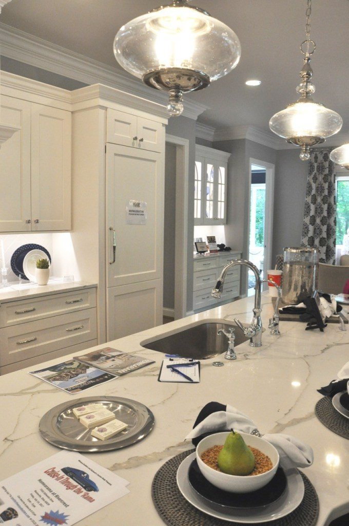 White kitchen with island and white countertops