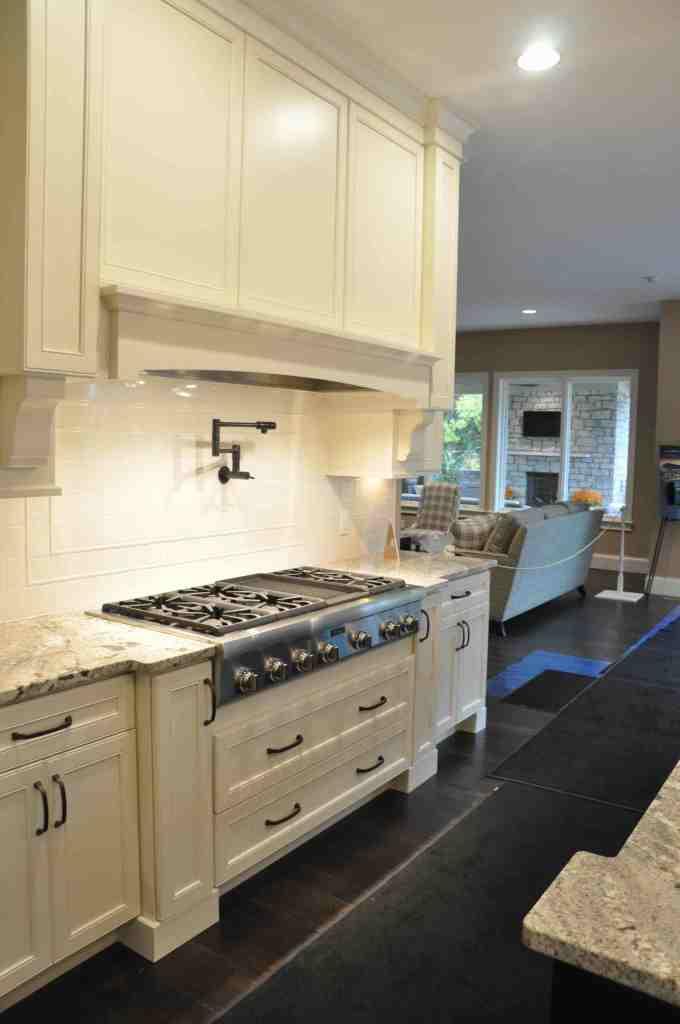 White kitchen with white range hood