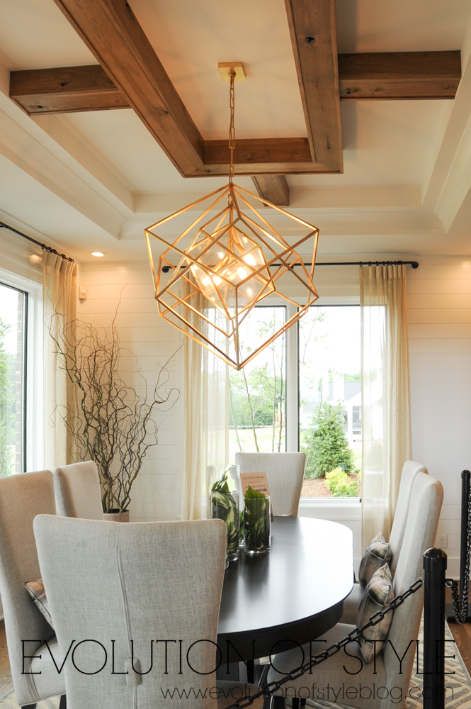 Dining area with gold chandelier