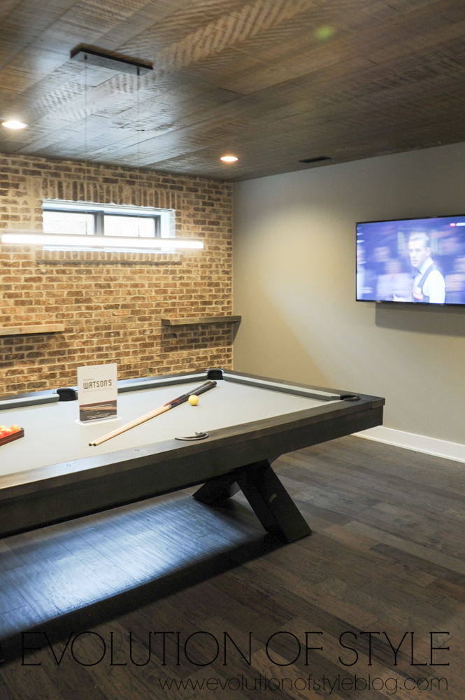 Pool table room with exposed brick