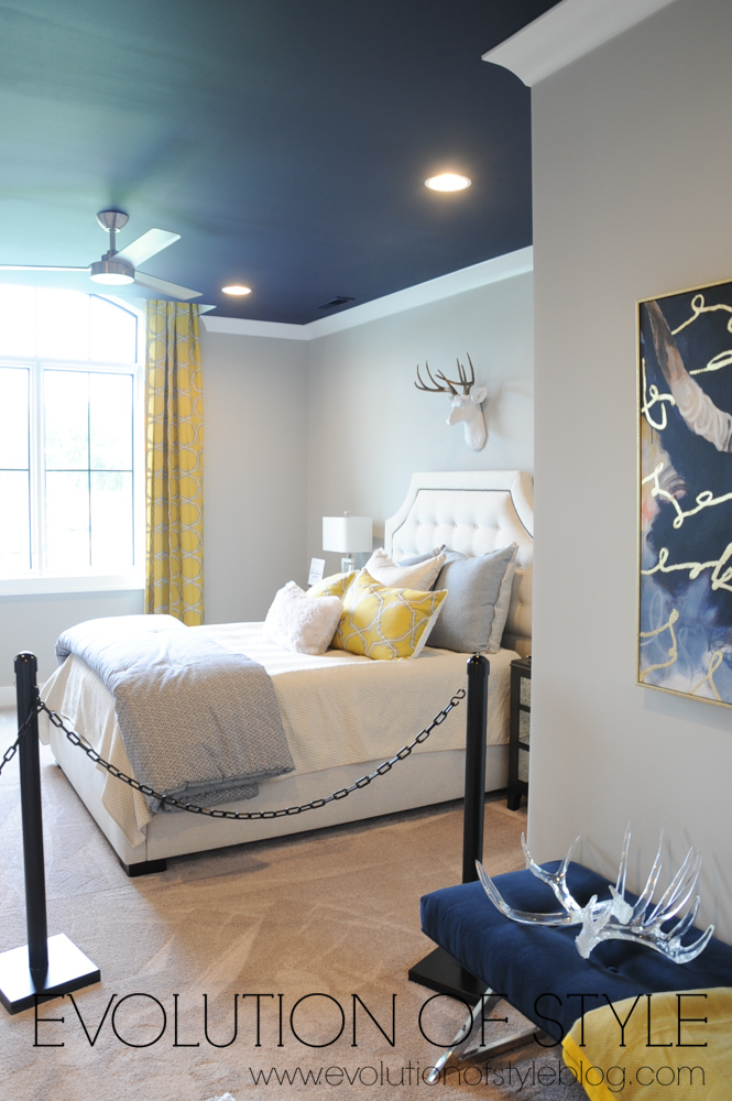 Bedroom with navy blue ceiling