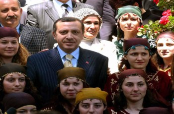 KOMOTINI, GREECE:  Turkish Prime Minister Recep Tayyip Erdogan (C) poses for a photo with traditional dressed Muslim girls in the northern Greek border town of Komotini 08 May 2004. Erdogan visited the county of Thrace, northern Greece, which counts some 115,000 Muslims. AFP PHOTO/ STR  (Photo credit should read STR/AFP/Getty Images)