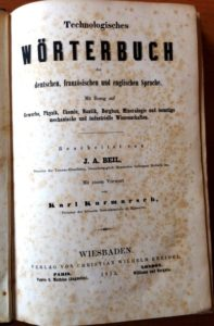 An original copy of the first edition of a Technological Dictionary of the German, French, and English Languages can be seen at EVS Translations office
