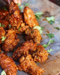Crispy, fried garlic chicken wings tossed in a sweet and sticky glaze. You won't be able to keep your hands off of these!