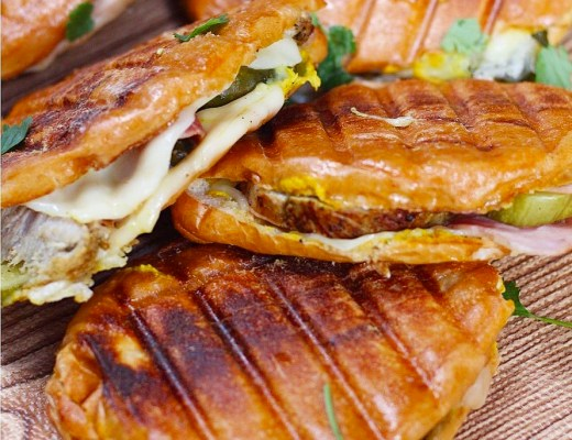 Classic Cuban sandwiches with mojo pork, crispy ham, dill pickles, and lots of mustard!!