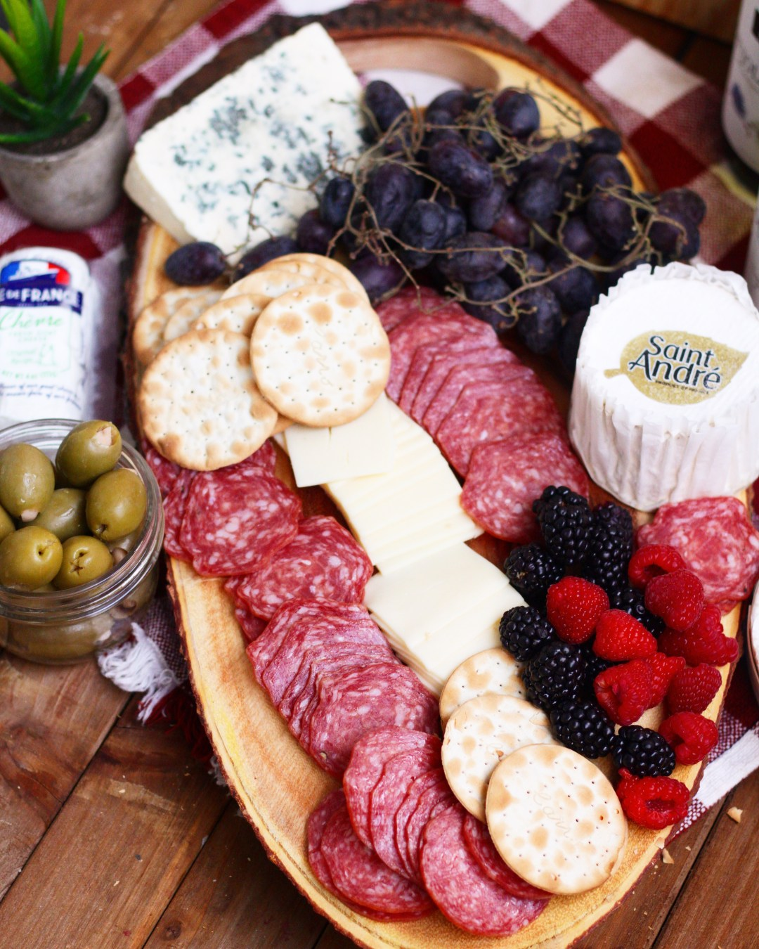 Take a trip to France with this French Inspired Charcuterie Board! Perfect holiday board of assorted meats, cheeses, and wines all from France! #ad